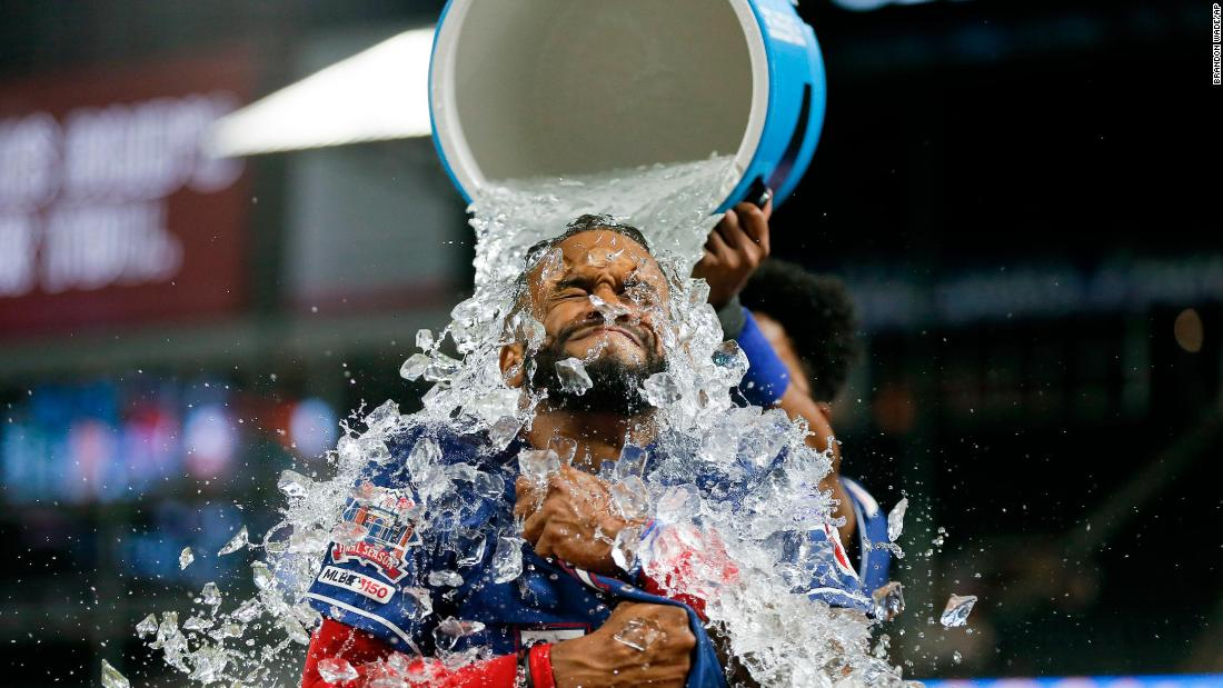 Texas Rangers' Delino DeShields receives an ice water shower from Elvis Andrus after hitting a game-winning RBI single in the 12th inning of the team's baseball game against the Baltimore Orioles, Wednesday, June 5, 2019, in Arlington, Texas. Texas won 2-1.