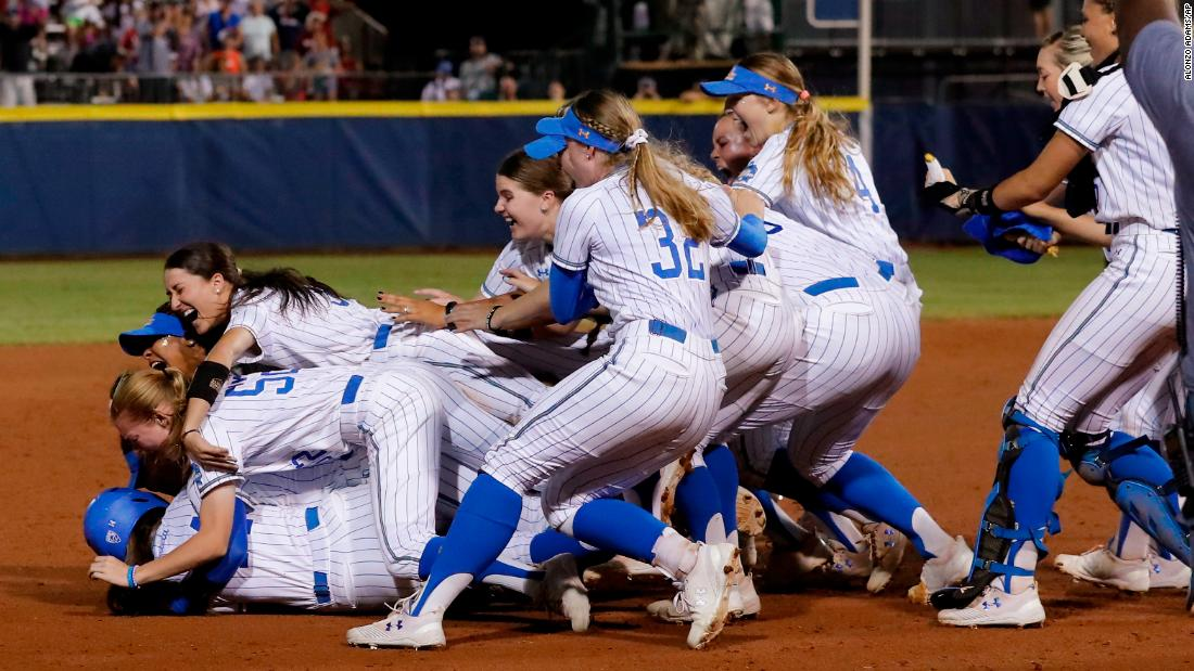 UCLA players celebrate  after defeating Oklahoma in the NCAA softball Women's College World Series in Oklahoma City, Tuesday, June 4, 2019. UCLA won 5-4 in Game 2, taking both games in the best-of-three series.