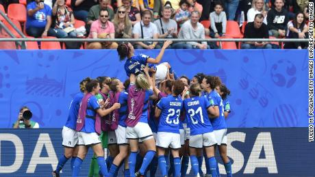 Players of Italy throw Bonansea in the air.