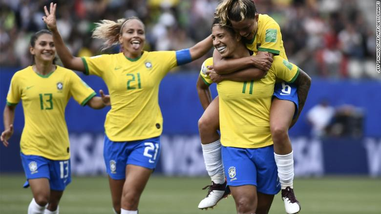 Cristiane (2ndR) is congratulated by teammates after scoring.