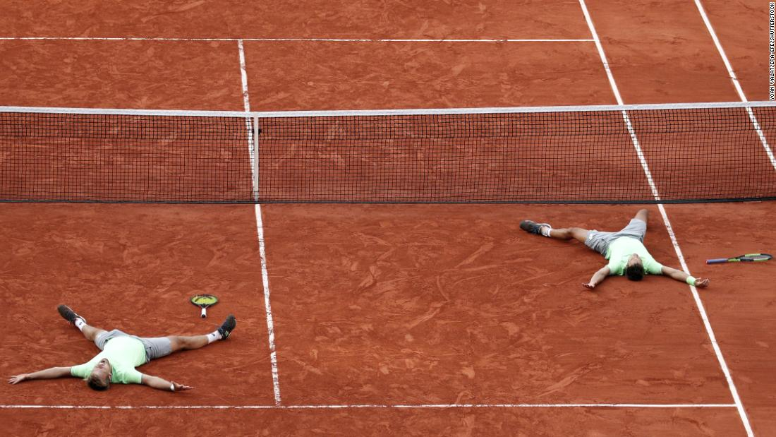 Kevin Krawietz, left, and Andreas Mies, right, of Germany react after winning the men's doubles final match during the French Open tennis tournament at Roland Garros in Paris on June 8,  2019.
