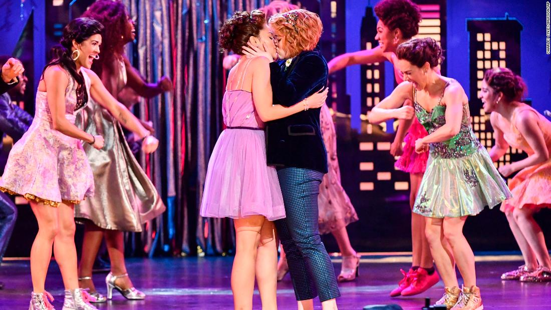 "Isabelle McCalla, left, and Caitlin Kinnunen, of ""The Prom,"" kiss while performing during the Tony Awards."