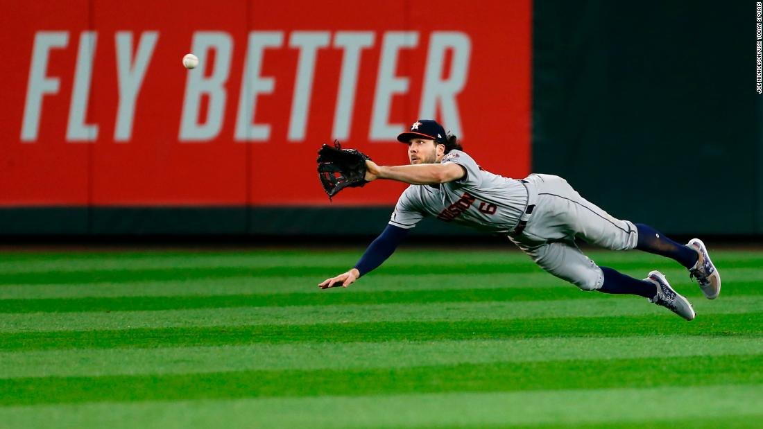 Houston Astros center fielder Jake Marisnick makes a diving catch against the Seattle Mariners eighth inning at T-Mobile Park.