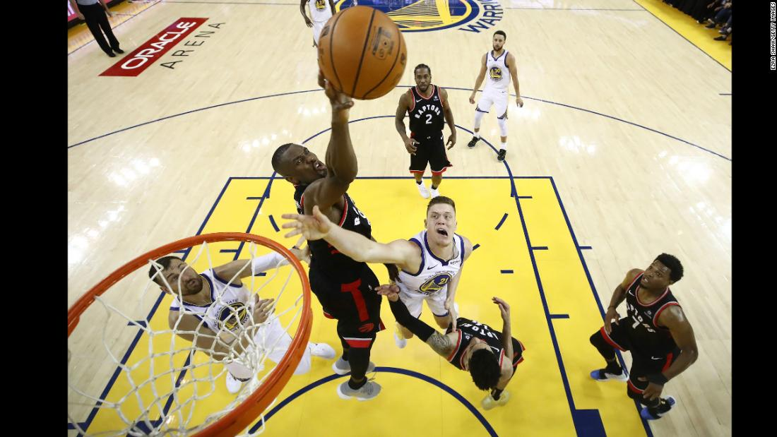Jonas Jerebko of the Golden State Warriors attempts a shot against Serge Ibaka of the Toronto Raptors in the second half during Game Three of the 2019 NBA Finals at ORACLE Arena on June 5, 2019 in Oakland.
