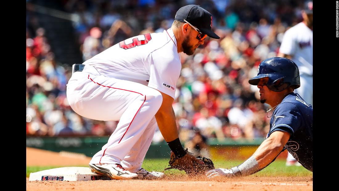 Willy Adames #1 of the Tampa Bay Rays is tagged out at first base by Michael Chavis #23 of the Boston Red Sox in the fourth inning during game one of a double header at Fenway Park on June 8, 2019 in Boston.