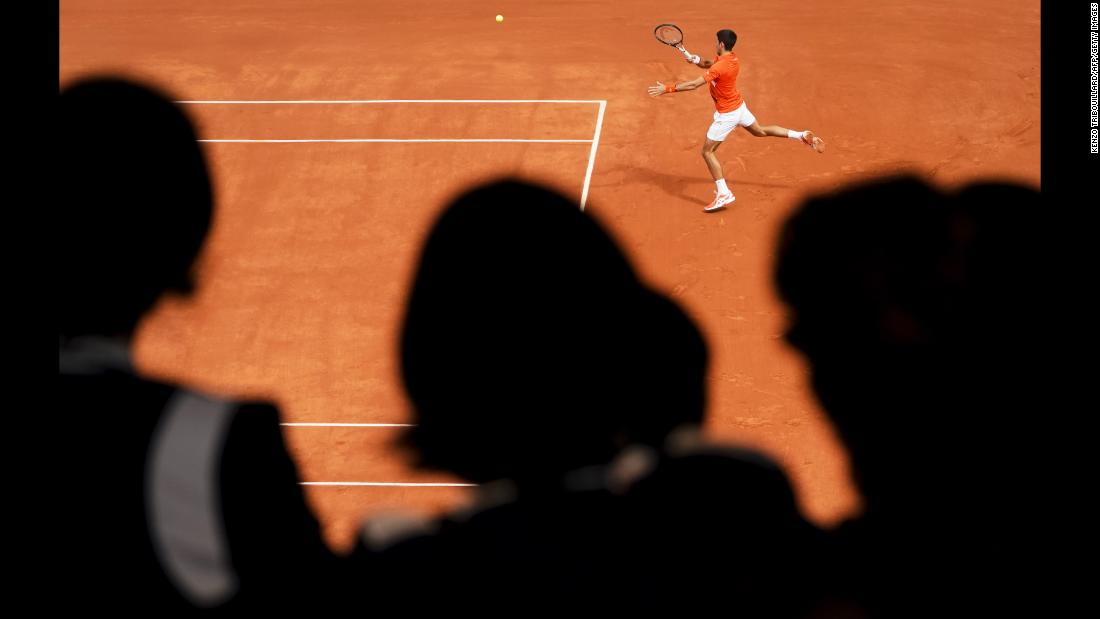Serbia's Novak Djokovic returns the ball to Austria's Dominic Thiem during their men's singles semi-final match on day 13 of the Roland Garros 2019 French Open tennis tournament in Paris on June 7, 2019.