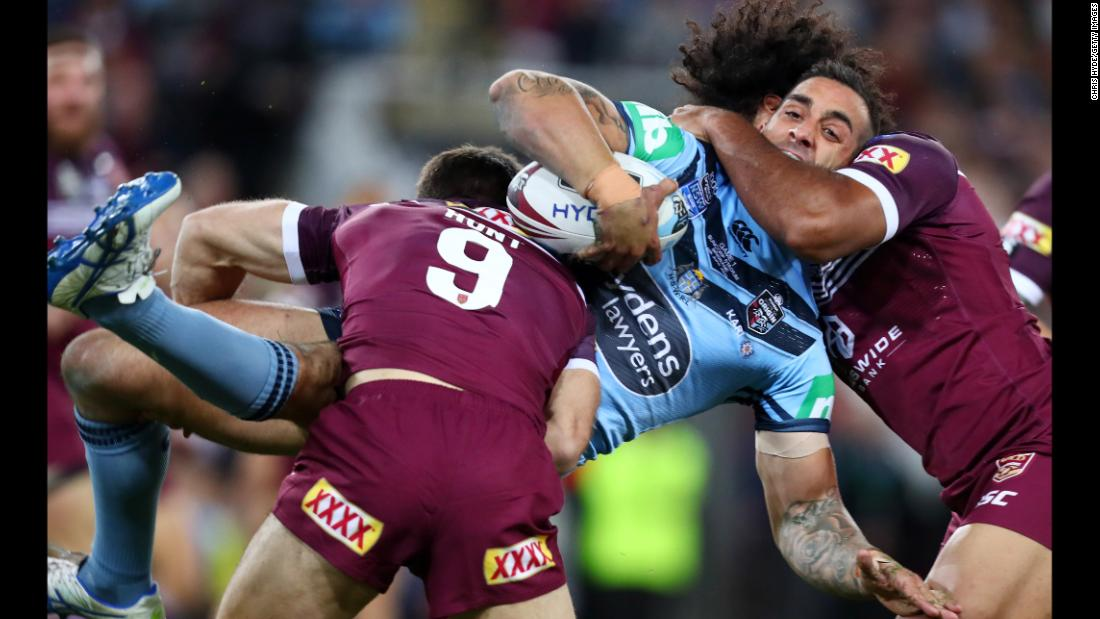 Paul Vaughan of the Blues is tackled during game one of the 2019 State of Origin series between the Queensland Maroons and the New South Wales Blues at Suncorp Stadium on June 5, 2019 in Brisbane, Australia.