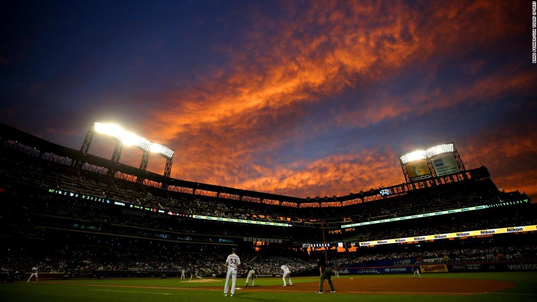 Sunset is seen over Citi Field during the fourth inning between the New York Mets and the Colorado Rockies.