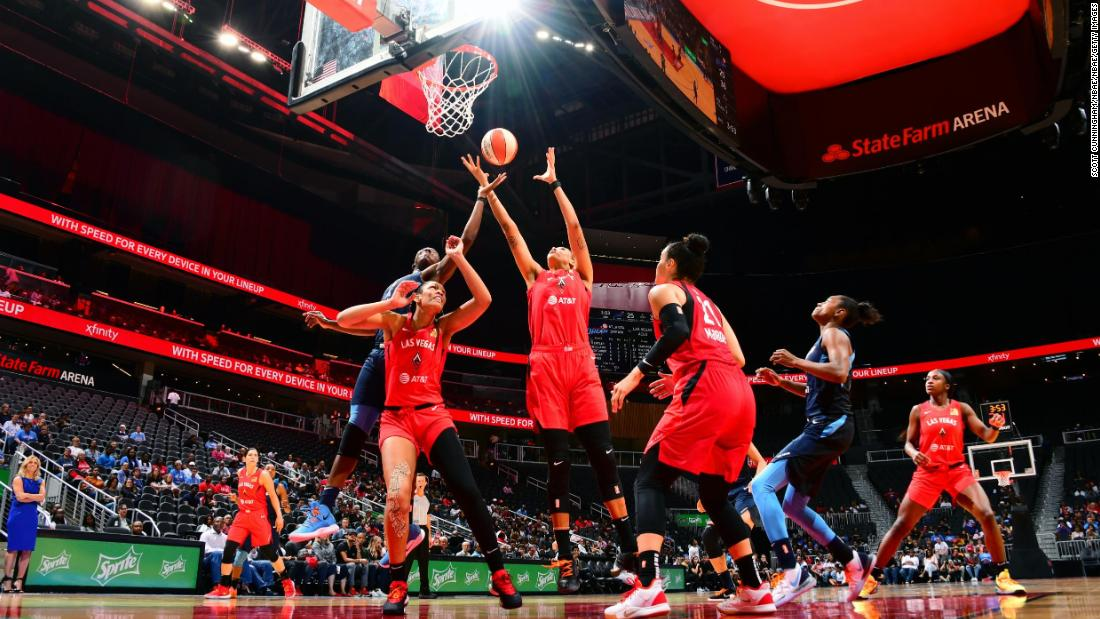 Liz Cambage #8 of the Las Vegas Aces rebounds the ball against the Atlanta Dream on June 6, 2019, at State Farm Arena in Atlanta, Georgia.
