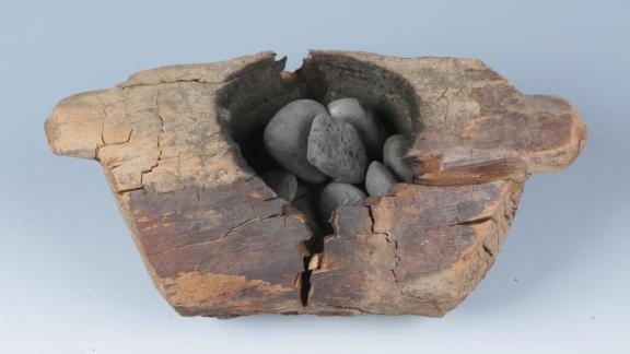 The brazier and burnt stones.