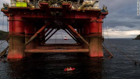 A Greenpeace boat pictured beneath the oil rig bound for the North Sea on Sunday.