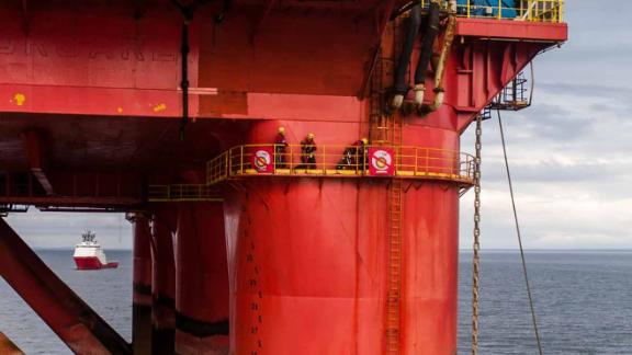 Greenpeace activists pictured on the oil rig in Cromarty Firth, Scotland.