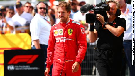 MONTREAL, QC - JUNE 09:  Sebastian Vettel of Germany and Ferrari walks in to parc ferme to swap the 1st and 2nd place boards after the F1 Grand Prix of Canada at Circuit Gilles Villeneuve on June 9, 2019 in Montreal, Canada.  (Photo by Dan Istitene/Getty Images)
