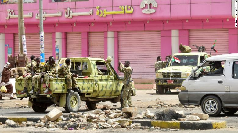 Sudanese soldiers guard a street in Khartoum on June 9, 2019.