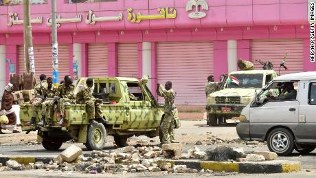Sudanese soldiers stand guard on a street in Khartoum on June 9.