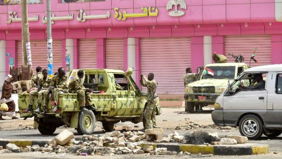 TOPSHOT - Sudanese soldiers stand guard a street in Khartoum on June 9, 2019. - Sudanese police fired tear gas Sunday at protesters taking part in the first day of a civil disobedience campaign, called in the wake of a deadly crackdown on demonstrators. Protesters gathered tyres, tree trunks and rocks to build new roadblocks in Khartoum's northern Bahari district, a witness told AFP, but riot police swiftly moved in and fired tear gas at them. (Photo by - / AFP)        (Photo credit should read -/AFP/Getty Images)