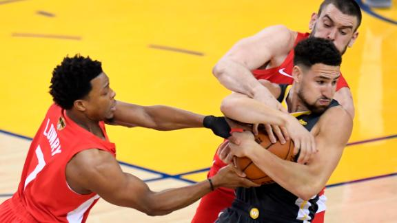 Lowry, left, and Marc Gasol double-team Thompson during Game 4 on Friday, June 7. The Raptors frustrated the high-powered Warriors en route to a 105-92 victory.