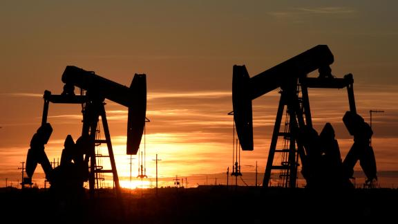 FILE PHOTO: Pump jacks operate at sunset in an oil field in Midland, Texas U.S. August 22, 2018. Picture taken August 22, 2018. REUTERS/Nick Oxford/File Photo