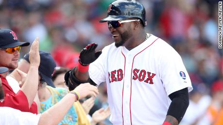 FILE PHOTO: Boston Red Sox designated hitter David Ortiz celebrates his solo home in the sixth inning against the Toronto Blue Jays during their MLB American League East baseball game in Boston, Massachusetts, September 22, 2013.  REUTERS/Dominick Reuter/File Photo