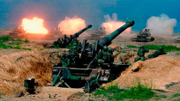 "US-made CM-11 tanks (in background) are fired in front of two 8-inch self-propelled artillery guns during the 35th ""Han Kuang"" (Han Glory) military drill in southern Taiwan's Pingtung county on May 30, 2019. - The manoeuvres in Taiwan come after the US, Japan, South Korea and Australia kicked off operation ""Pacific Vanguard"" near Guam, bringing together more than 3,000 sailors from the four countries last week. (Photo by Sam YEH / AFP)        (Photo credit should read SAM YEH/AFP/Getty Images)"