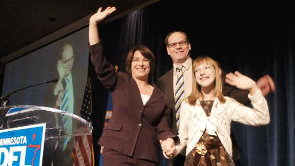 Klobuchar celebrates with her husband and daughter after she was elected to the Senate in November 2006. Klobuchar won 58% of the vote to become the state