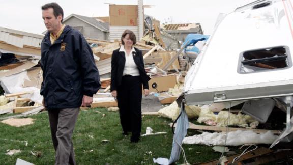 Klobuchar and Minnesota Gov. Tim Pawlenty survey homes that were destroyed by a storm in Hugo, Minnesota, in May 2008.