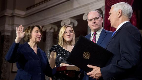 Klobuchar is joined by her husband and daughter as Vice President Mike Pence administers the Senate oath of office in January 2019. Klobuchar was just starting her third term in office.