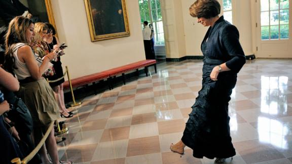 Klobuchar shows off her shoes to the press as she attends a White House dinner for German Chancellor Angela Merkel in June 2011.
