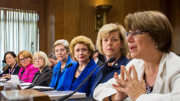 Klobuchar, right, is joined by other female senators as she testifies during a Senate subcommittee hearing about violence and discrimination against women.