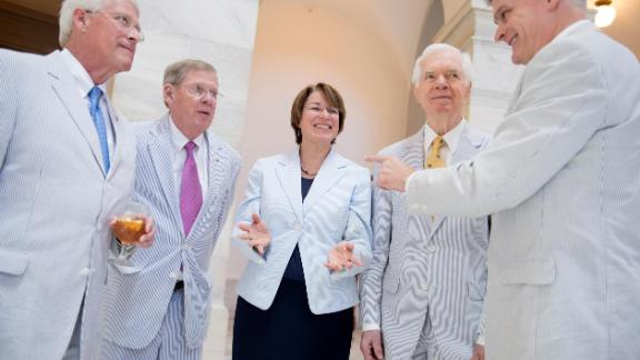 Klobuchar and several of her Senate colleagues attend a photo shoot for National Seersucker Day in June 2016.