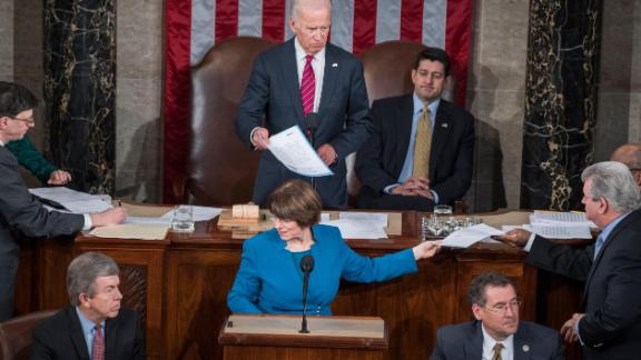 Klobuchar helps count Electoral College votes during a joint session of Congress in January 2016.