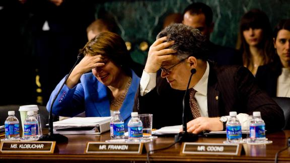 In March 2013, Klobuchar and US Sen. Al Franken attend a Senate hearing about a measure that would reinstate a ban on assault weapons.