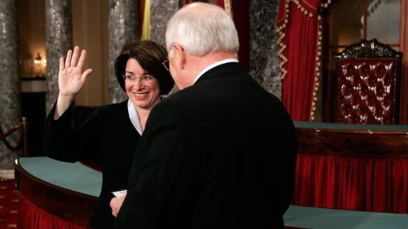 Klobuchar participates in a ceremonial swearing-in with Vice President Dick Cheney in January 2007.