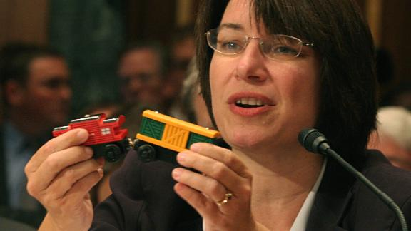 Klobuchar holds a toy train with lead paint as she testifies before a Senate subcommittee about toy safety standards in September 2007.