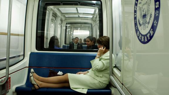Klobuchar talks on her cell phone as she rides the Capitol subway in July 2008.