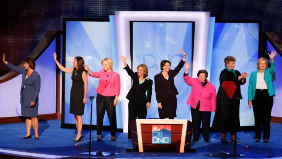 Klobuchar, fifth from left, joins other female senators on stage at the Democratic National Convention in August 2008.