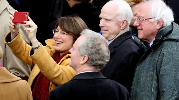 During the inauguration of President Donald Trump, Klobuchar takes a selfie with, from left, US Sens. Chris Van Hollen, John McCain and Bernie Sanders.
