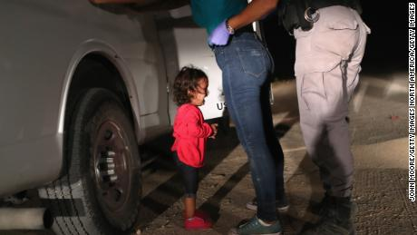 A 2-year-old Honduran asylum seeker cries as her mother is detained near the US-Mexico border in June 2018.