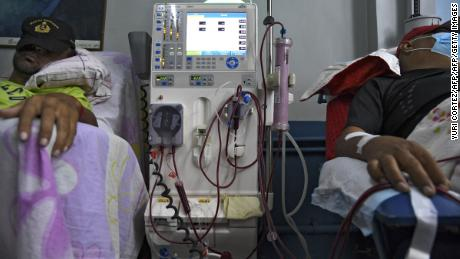 Patients suffering from renal failure receive hemodialysis treatment at a clinic in Barquisimeto, Venezuela, on April 24, 2019. - For cronic patients humanitarian aid is still far away. The fist stage of the aid is expected to last a year and will assist 650,000 people. Medicines for cronic patients are contemplated in a second stage. (Photo by YURI CORTEZ / AFP)        (Photo credit should read YURI CORTEZ/AFP/Getty Images)