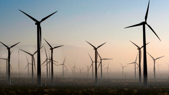 PALM SPRINGS, CALIFORNIA - FEBRUARY 27, 2019: Wind turbines generate electricity at the San Gorgonio Pass Wind Farm near Palm Springs, California, as a dust storm blows through the area. Located in the windy gap between Southern California's two highest mountains, the facility is one of three major wind farms in California. (Photo by Robert Alexander/Getty Images)