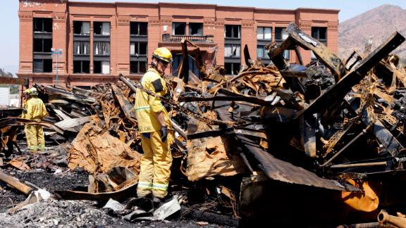 Los Angeles County firefighter Darrick Woolever examines metal that needs to be removed at the Universal Studios Hollywood back lot, a day after the fire in June 2008.