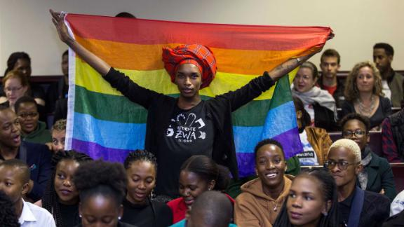 An activist holding up a rainbow flag, celebrating when high court judges in Gaborne struck down colonial-era sodomy laws.