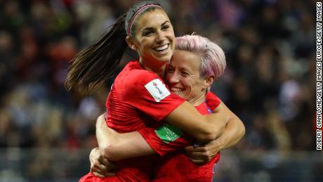 REIMS, FRANCE - JUNE 11: Alex Morgan of the USA celebrates with teammate Megan Rapinoe after scoring her team's twelfth goal during the 2019 FIFA Women's World Cup France group F match between USA and Thailand at Stade Auguste Delaune on June 11, 2019 in Reims, France. (Photo by Robert Cianflone/Getty Images)