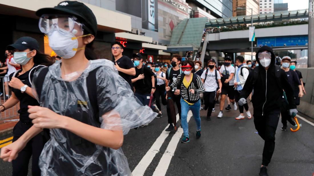 Hong Kong police fire rubber bullets and tear gas into China extradition bill demonstrators