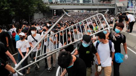 The protesters carry barricades when they go to the legislative council.