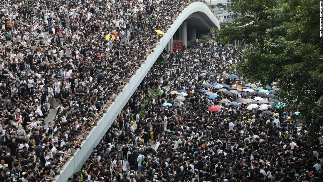 By the morning of June 12, tens of thousands of mainly young people had arrived in the area, blocking streets and bringing central Hong Kong to a standstill.