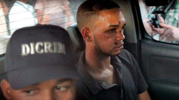 Eddy Vladimir Féliz Garcia, in custody in connection with the shooting, is transported by police to court.