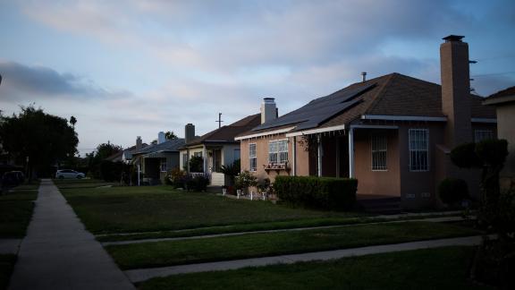 Houses line the street in the Crenshaw neighborhood of Los Angeles.