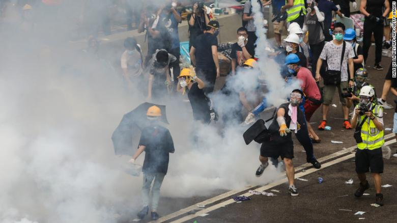 Hong Kong protesters face off with riot police