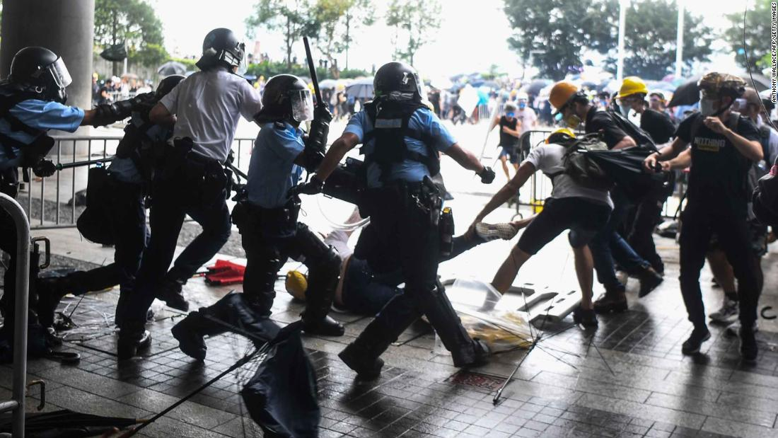 Police and protesters clash outside the Legislative Council building on June 12.